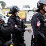 Photo: Riot police preparing to contain people who were detained for violating El Salvador's nationwide lockdown measures in San Salvador, El Salvador [Jose Cabezas/Reuters]